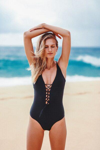 model in sporty swimwear issa de mar one piece black