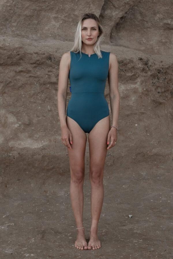 woman surfer wearing green rash guard