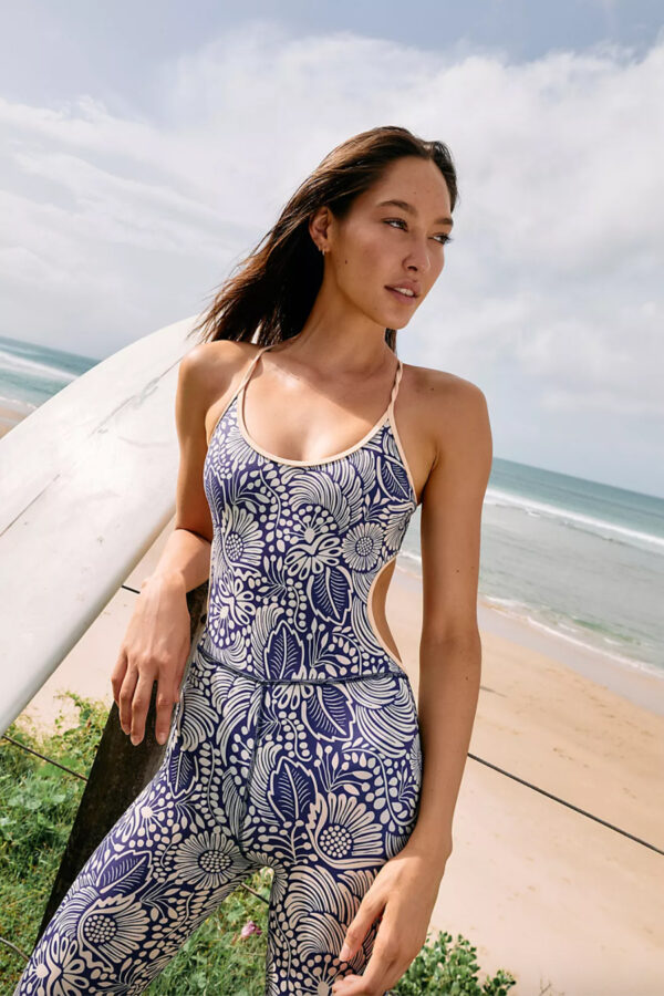 woman wearing cute surf suit at the beach