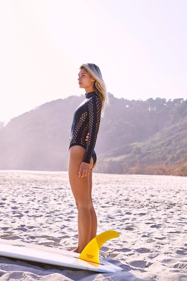 woman surfer wearing cute black surf suit