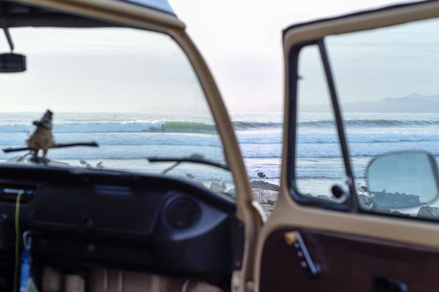 view of surfing through vw camper windshield from morro bay parking lot