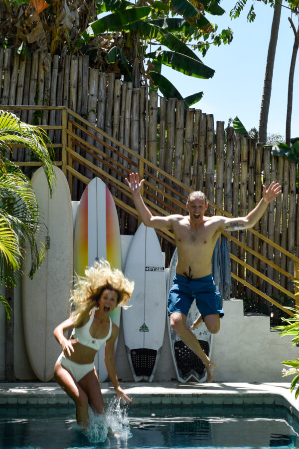 jumping into pool santa teresa costa rica surf trip