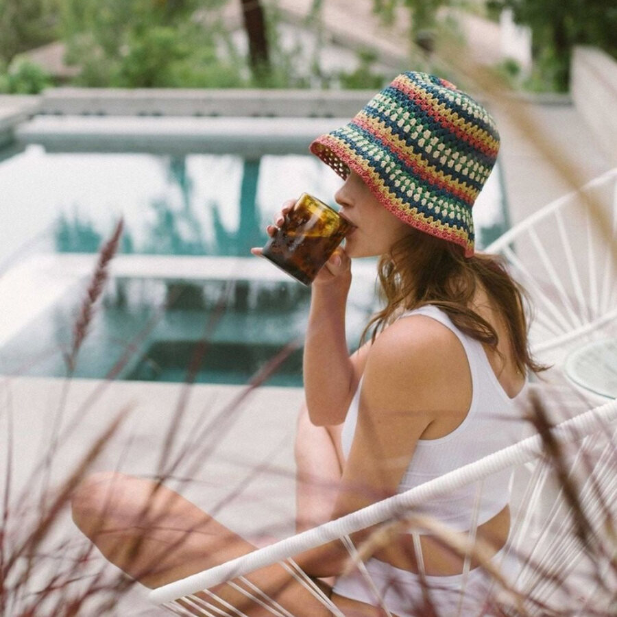 woman wearing colorful bucket hat by surf brand Brixton