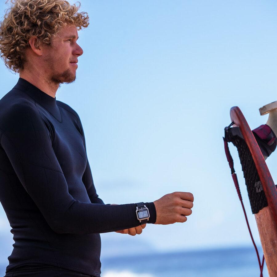 pro surfer john john florence wearing surf watch by nixon
