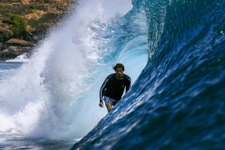 Surfer in large wave wearing Vissla