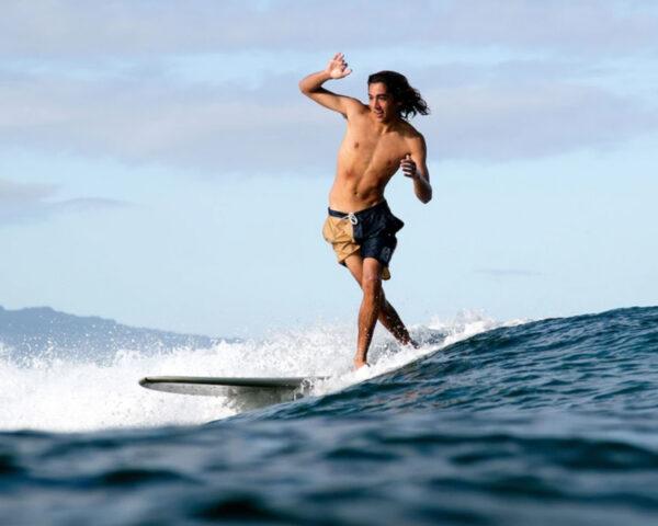 Surfer longboarding in Katin boardshorts