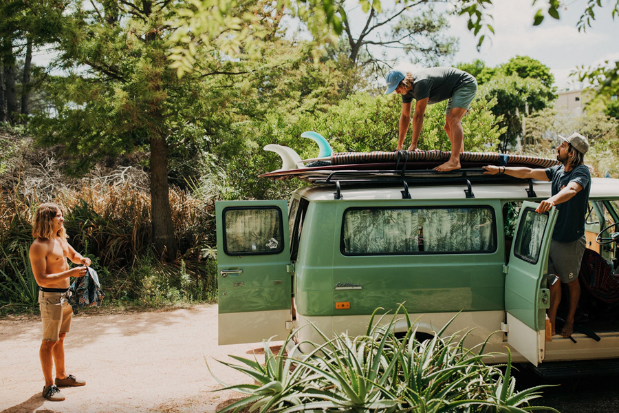 surfers loading car for surf trip - wearing Howler Brothers surf brand