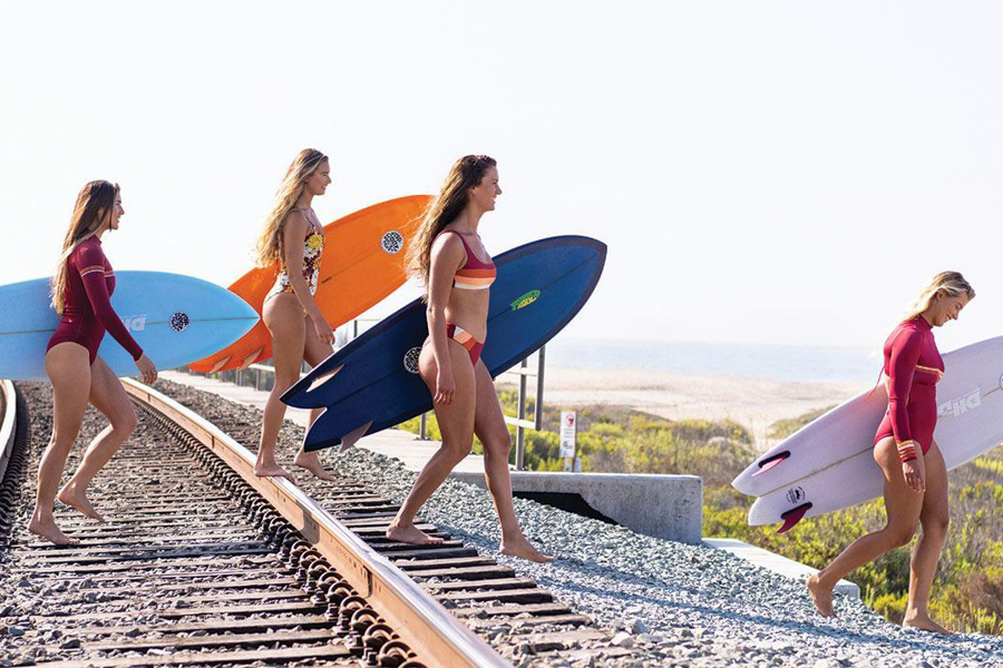 rip curl women's surf team walking with surfboards
