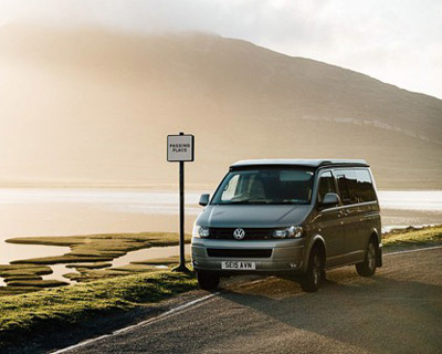vw van with picturesque mountain lake scenery