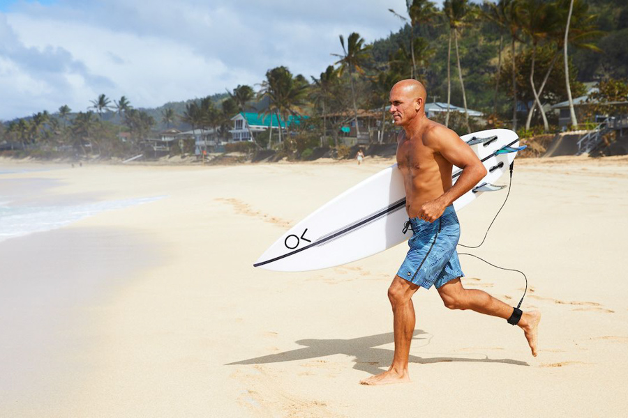 kelly slater wearing boardshorts by outerknown surf brand