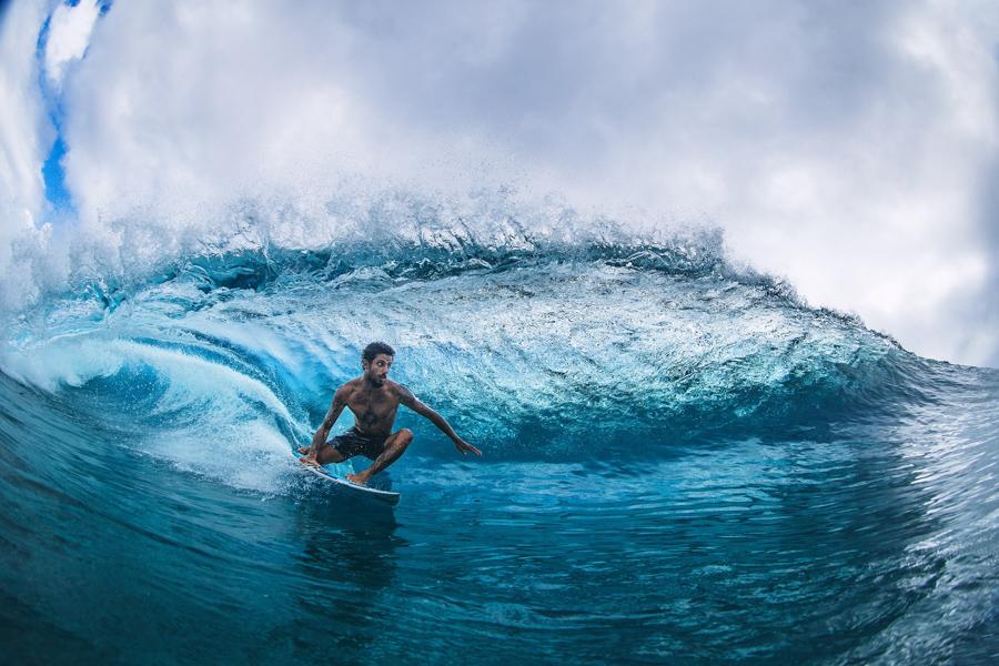 pro surfer filipe toledo surfing barrel wearing boardshorts by hurley surf brand