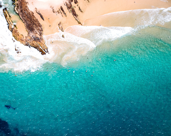 aerial drone shot of picturesque surf beach