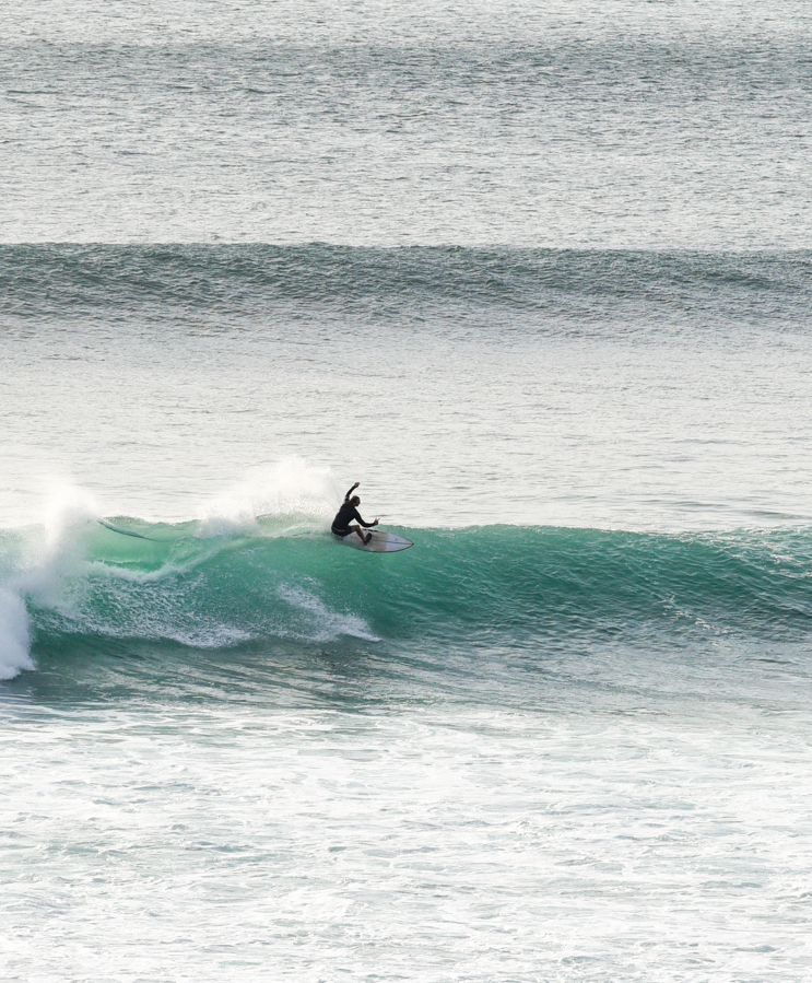 person surfing wave at impossibles bali