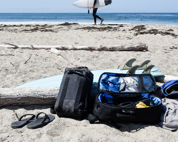 various surf gear and equipment on beach at trestles
