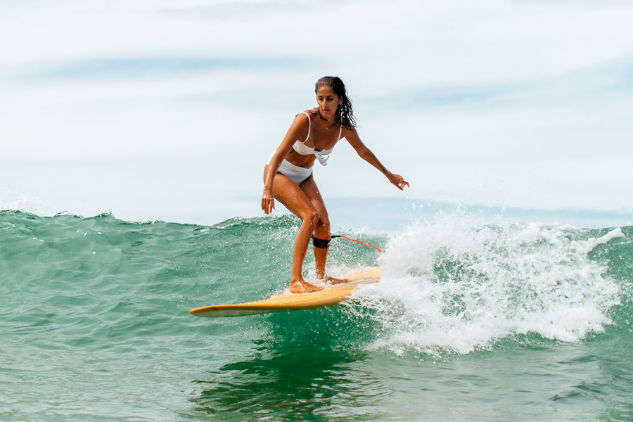 beginner surfer learning how to surf