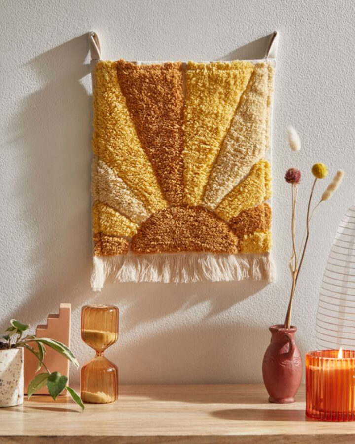 Retro wall art hanging with a yellow sun