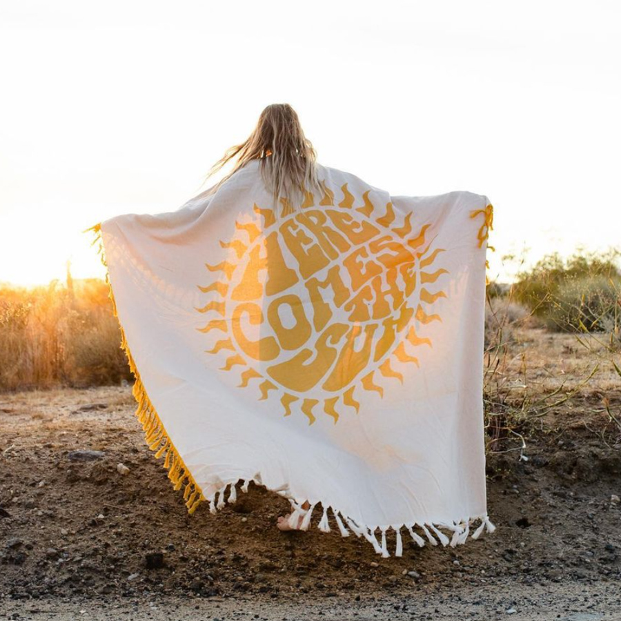 cute yellow beach blanket that says here comes the sun