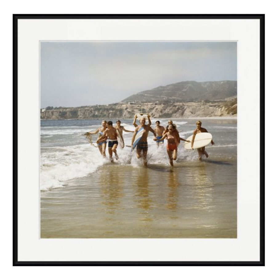 Vintage surf photography print of people running on the beach with surfboards