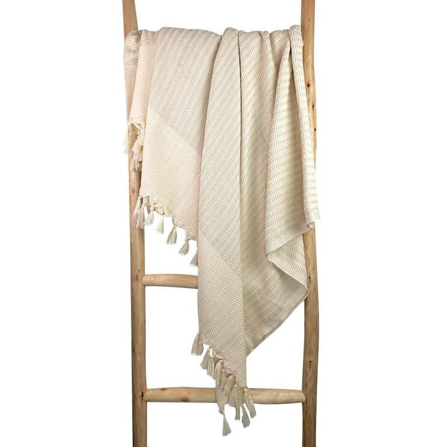 white and beige turkish beach blanket