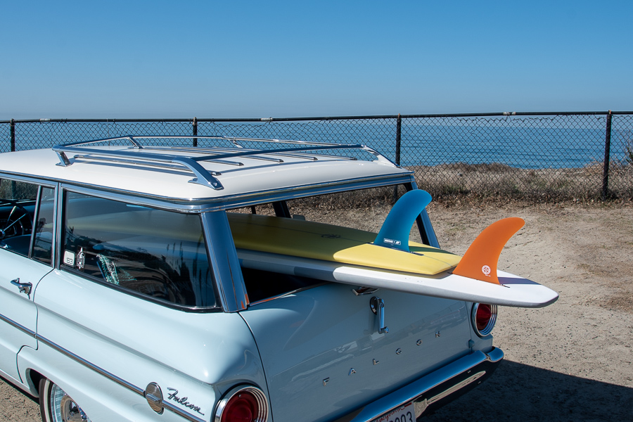 Vintage car with two surfboards at the ocean