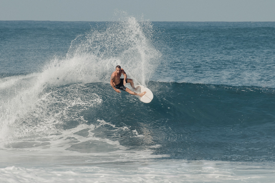 Man surfing wave - How to choose a surfboard depends on your level of surfing