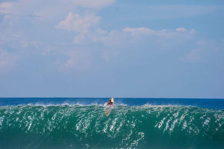 A surfer going over a wave at Zicatela, Puerto Escondido